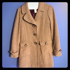 Gray wool peacoat. I have loved this jacket for almost 10 years... Have worn the heck out of it, but unfortunately it has become too small for me . I'm so sad to let it go, but I hope someone else will love it as much as I do! It was my staple jacket through college - would fit best on a small-medium frame. Just had it taken in to have the buttons tightened and a tear in the purple inner lining fixed. All pilling has been removed. It's in great shape! There's a small, hardly noticeable…