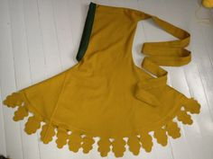 Hood with leaves. Yellow wool with green wool lining. Handsewn with silk. Demo of how it was made in blog post.