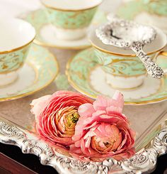 """Team a beautiful silver tray with ornate china for a winning combination.  """"Darley Abbey"""" bone china teacups and dinnerware are from Royal Crown Derby and the Wallace sterling silver tray is from Replacements."""