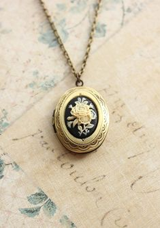 Oval Locket Necklace Ivory Flower Black Cameo by apocketofposies