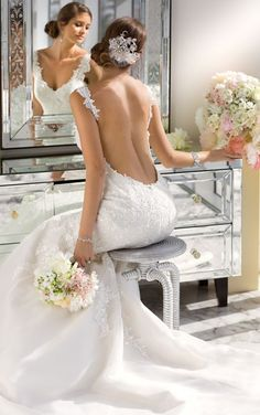 Beautiful Back View: Essense of Australia Style D1616. Decadent beaded fit and flare low back wedding dress features a sweetheart neckline and fitted bodice. #EssenseBride #WeddingDress