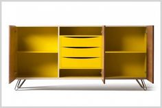 SHERWOOD, Sideboard made of maple wood, 3 doors finely veneered with walnut. Colorful interior with adjustable shelves and 3 drawers in the central room. Steel feet. by Maurizio Duranti