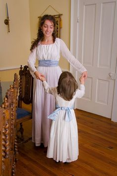 I made these dresses for my girls. Sense and Sensibility patterns. Love them.
