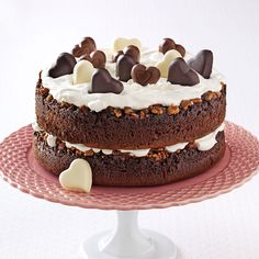Chocolate-Praline Layer Cake Recipe -For the chocolate-lover in all of us, this dessert is the one. Packed with pecans, the luscious layers are topped off with heart-shaped chocolate candies. Every day is Valentine's Day with this cake!—Kathy Engler, Brookfield, Wisconsin