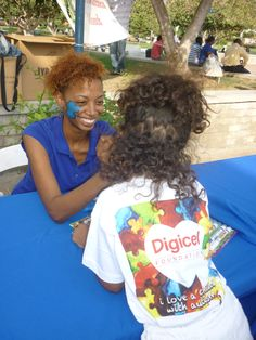 Child getting her face painted at the World Autism Awareness Day Event on April 2, 2012 at Emancipation Park