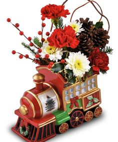 The Spode Holiday Express - A hand-painted, porcelain, collector's edition keepsake featuring a train design with gold trim and the famous Christmas tree motif and Blossom Flower Shops is one of the few exclusive florists carrying this item. Each collectible train is packaged in a custom made collector's gift box.