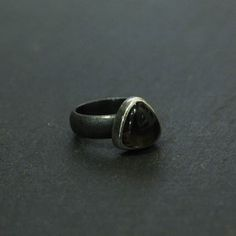 Smokey quartz trillion ring on an oxidised band designed and made by Leoma Drew. <br /> The oxidised silver is waxed helping to protect it and last longer, it gradually reveals a gunmetal colour which may lighten and evolve over time.