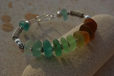 Wire wrapped seaglass bangle.