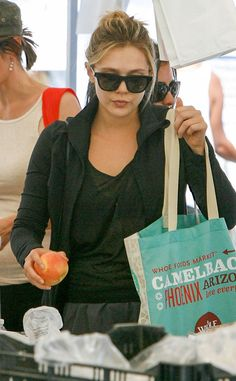 Elizabeth Olsen hit up a farmer's market in shady style! Gotta love her versatile, yet totally trendy, black square sunnies!
