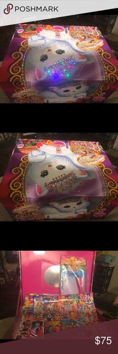 Lisa frank box full of memorabilia & hair products Box lights up and is stuffed with hair products and stickers and post cards and crayons and markers and the box lights up!!!! Has a small dent on side of lid Other