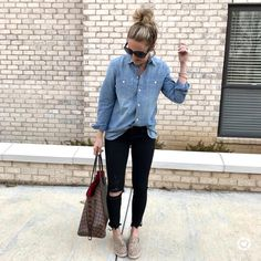 woman wearing blue denim western shirt, distressed black denim jeans, pair of brown slip-on shoes, and Damier Ebene Louis Vuitton tote bag outfit. Distressed Jeans Outfit, Black Jeans Outfit, Black Denim Jeans, Blue Denim, Jean Shirt Outfits, Looks Camisa Jeans, Casual Outfits, Cute Outfits, Work Outfits