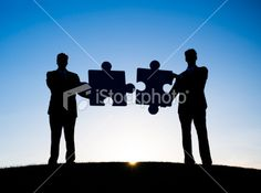 Two Businessmen holding the jigsaw puzzle Royalty Free Stock Photo