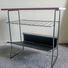 Bekijk dit items in mijn Etsy shop https://www.etsy.com/nl/listing/539689936/vintage-mid-century-magazine-rack