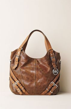 Michael Kors Milo Tote. $500. Never gonna happen but it is a lovely principle piece.