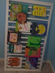 repurposed crib rail...to make a book rack:)