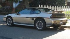 Pontiac Fiero GT.  When you were 2 ('till 5), this silver color was exactly our ride.  The best car I ever owned.  Awesome, sunroof, loaded.  Problem became the 2 seats.  Not enough room for Rotties or Baby-sitters.