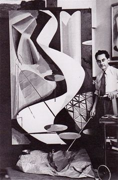 Man Ray in his studio. Paris c. 1939. Like a lot of great photographers he also produced fine art.
