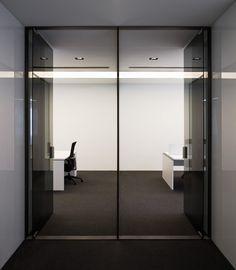 Glass entrance inside the Acer office in Barcelona by architect Francesc Rife _