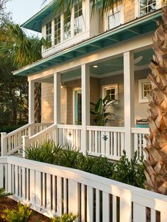 2013 HGTV Smart Home Front Yard Pictures. Planted between the picket fence and the front porch to draw attention, needle palm will grow to a height of 4-1/2 feet and provide needed massing in the landscape.