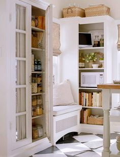 love this little seating area and the fabric interior of pantry doors