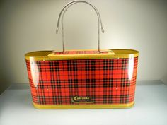 """Vintage 1953 Plaid Car-Snac Carrier, companion piece for Skotch Kooler, 1953, holding a thermos.  Marked """"Car-Snac Gotham Industries, Inc."""", Chicago"""