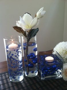 DIY Floating Pearl Centerpieces Step By Step Instructions With over 30 colors to choose from, our decorative jumbo pearls comes in many sizes from oversized jumbo pearls to small. Floating Flower Centerpieces, Pearl Centerpiece, Floating Candles Wedding, Floating Candle Centerpieces, Simple Centerpieces, Wedding Table Centerpieces, Unity Candle, Graduation Centerpiece, Blue Wedding Decorations