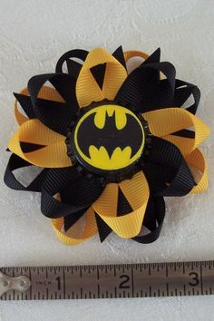 The Dark Knight Amazing Bottlecap Hair Bow Get inspired, DIY and save. Get your bottle cap craft supplies at www.fizzypops.com.