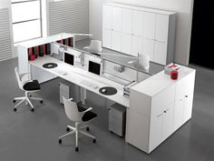 White work surfaces flanked by opened and closed storage, rolling files and a divider panel make this room both functional and visually appealing.  90degreeofficeconcepts.com