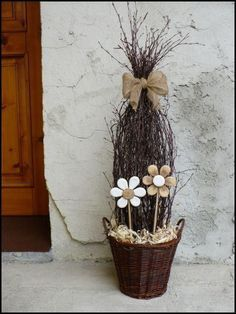 This is a neat idea but I would put real flowers (either yellow or purple for Easter) in the base instead of those neutral o… Deco Floral, Arte Floral, Wood Crafts, Diy And Crafts, Real Flowers, Spring Crafts, Porch Decorating, Easter Crafts, Flower Pots