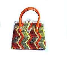 African Print Fabric Tote, Large Dashiki Print Tote Bag With leather Straps and lined with gold satin which includes a zipper closure. There is an interior pocket to hold keys, cell phones etc. And th