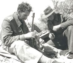 Captain Jake Easonsmith, and an unidentified trooper take a moment to filed strip and clean an M1928 Thompson. The desert had a habit of getting into every nook and cranny of weapons and men. A dirty weapon led to jams at the worst possible time. A dirty body led to desert sores, lice and other not so nice ailments. Easonsmith would go on to command the LRDG but was KIA during Operation Leopard on the Greek island of Leros.