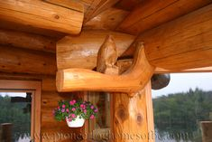 carving-bird-pioneer log homes