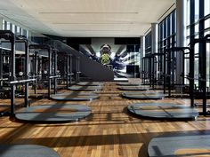 Weight room with regressed linear lighting.  I like that the regressed slots just become an architectural feature during the day.