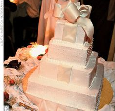 """For the finale to the feast, Jessica designed the """"delicious"""" white wedding cake with cannoli-cream filling to resemble a stack of gifts -- the only nod to the impending holiday."""