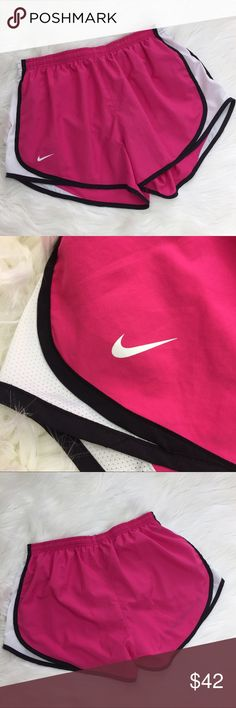 """Nike Dri-Fit Pink Black White Running Shorts •Nike Dri-Fit Pink Running Shorts •Women's Size Large •In excellent used condition •Built in underwear and inner key pocket •Pink with white mesh sides and black trim •Elastic waist with drawstrings •100% polyester •All measurements are approximate: 14"""" across waist Nike Shorts"""