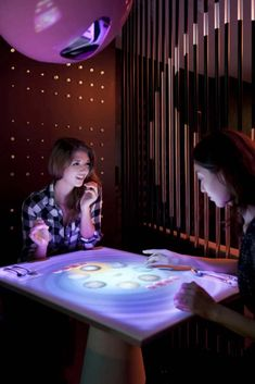 Very Cool! Restaurant interactive touch table enables diners to order directly from screen.