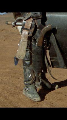 Max details of belt gear. Sam Browne belt, hydrant spanner, fire ax, shotgun, British Army knife