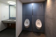 Toughened back-painted glass duct panels - installed by Washroom Washroom, 2014