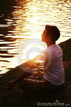 Young Indian man in deep meditation radiating light and peace