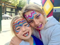 Sister's face painted by Cynnamon at Kids Day at tge Jammin on Haight Tie-Dye store in San Francisco, ca.