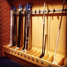 "The first thing on your left upon entering the locker room is the ""stick rack"". Storing the players' sticks next to the locker room entrance/exit makes for easy access when heading out onto the ice. #CBJAllAccess"