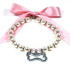 $29.99 Lovely pearl necklace with a bone charm inlaid with crystal stones and silk ribbon. Perfect for parties or events, or just making your pet look it's more adorable.Great holiday or birthday gift for dog or cat. For pets with a neck size of 10-12 inches.
