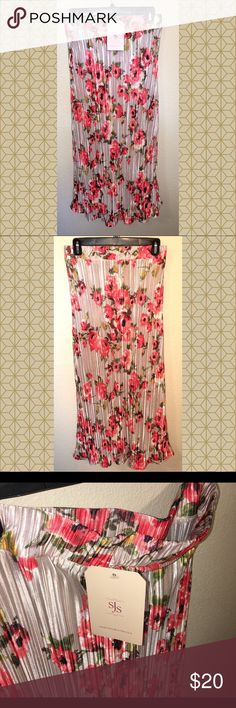 """NWT floral accordion maxi skirt. Medium NWT floral accordion style maxi skirt. Size medium. Cream background with bright floral colors. Elastic waistband, slight scallop flare out at hem. Would pair beautifully with solid airy blouse and rhinestone sandals. Great for work, weekend were as, girls brunch or church. Brand new. Smoke free home. 100% polyester. #floral #skirt #accordion #maxi #cream #nwt #medium #elastic ❌no trades❌ Measurements laying flat approx: Waist 14.5"""" Length 33"""" Skirts…"""