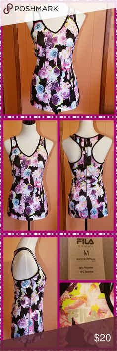 Colorful floral Dri-Fit tank top. This Fila Sport Dri-Fit tank top is adorable. V-neck front and racerback. Machine washable. Fila Tops Tank Tops