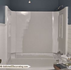 diy painted bathtub, bathroom ideas, painting, The first coat of paint going on You can see how dingy and drab the color of the tub was compared to the bright white paint #PaintingBathtub