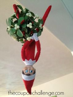 Hey - up here!  Can you see me?  Let your Elf hang by the mistletoe or from any decor you hang in the doorway.
