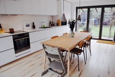White modern Ikea kitchen | Metod NODSTA | Habitat dining table & chairs | polished concrete pendant lights