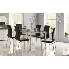 Houston Glass Dining Table and 4 Cantilever Black Chairs at Homebase -- Be inspired and make your house a home. Buy now.