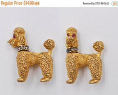 I have here a whimsical vintage poodle brooch from Napier! This fun brooch features a highly detailed and textured, gold poodle dog figure.