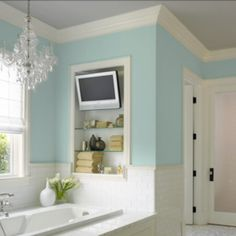 tv over the bathtub... Please tell me it's a jacuzzi tub!